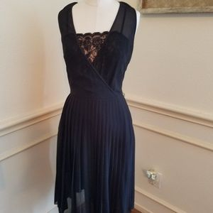 Black sheer dress with pleats